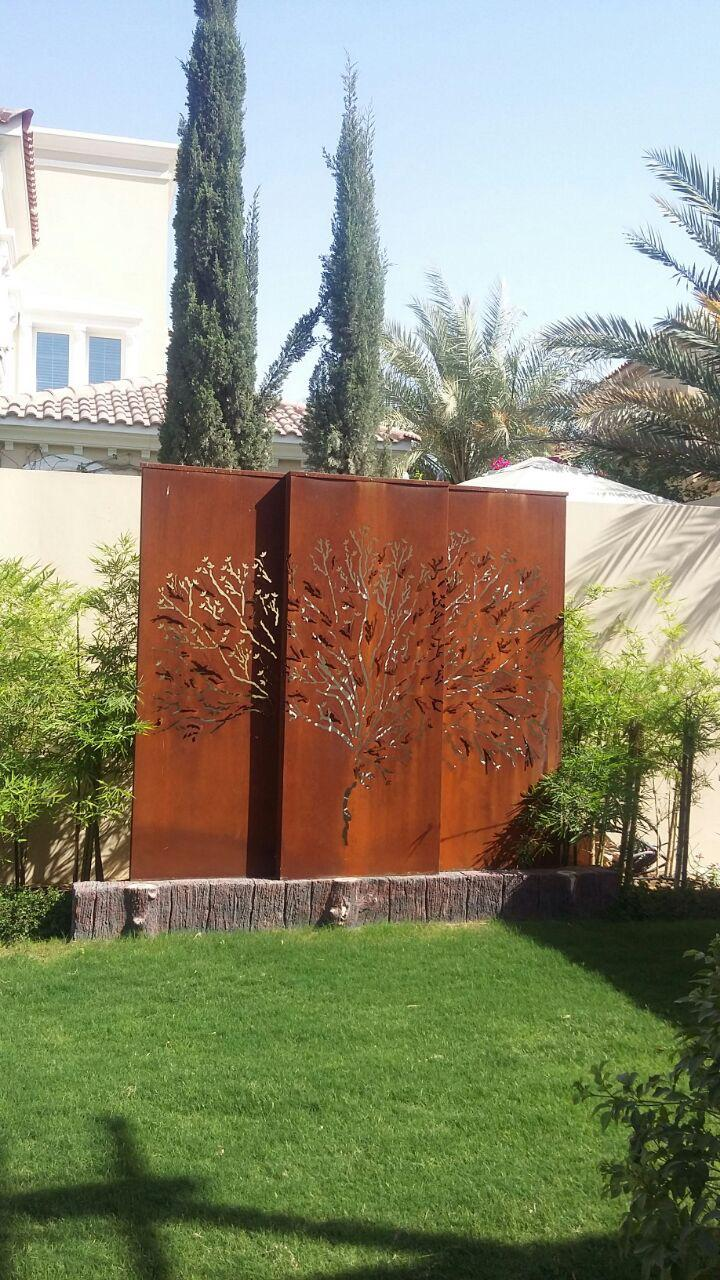 corten steel - a plastered boundary wall